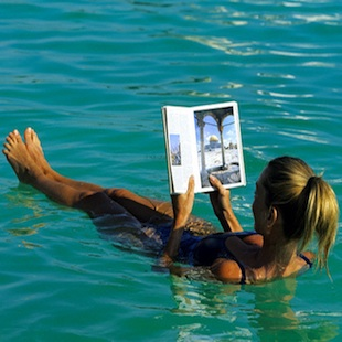 Israel, Jordan Valley (Dead Sea), en Boqueq, the sea's high content in salt allows swimmers to read in the water