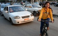 Female cyclists challenge local customs on Egyptian streets