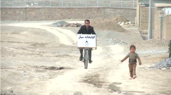 A teacher in Afghanistan turned his bike into a mobile library and cruises the countryside giving kids a chance to read