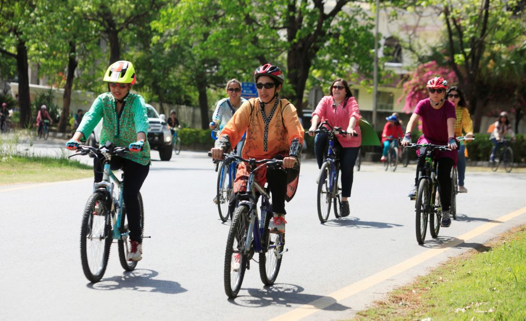 Tired of abuse, Pakistani feminists ride bikes to claim public space
