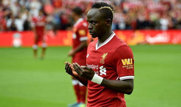 Liverpool star Sadio Mane helps to clean local mosque